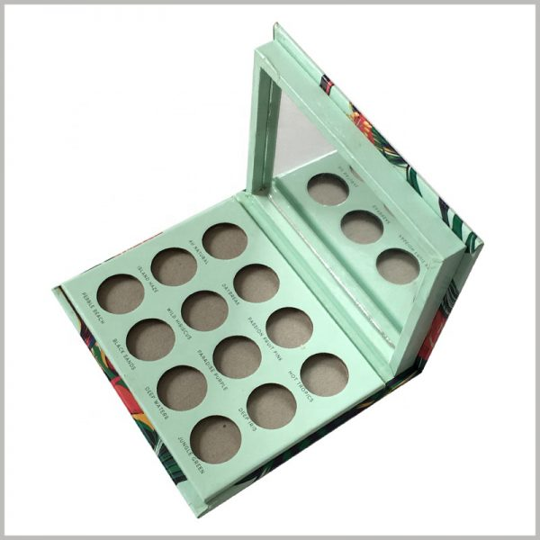 12 color eyeshadow palette packaging with mirror.The interior of the custom packaging is light green, promoting the concept of pure natural cosmetics.