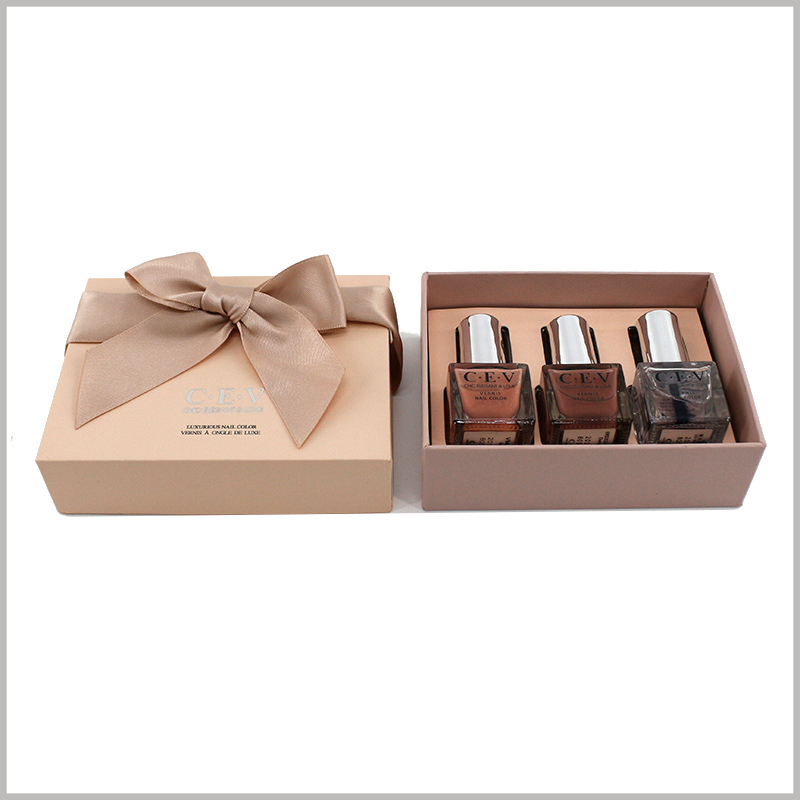 3 bottles of nail polish gift boxes packaging. The overall color of the customized cosmetic packaging is the same, and the outer box, gift bows, EVA laminated paper, etc. all use a unified color.