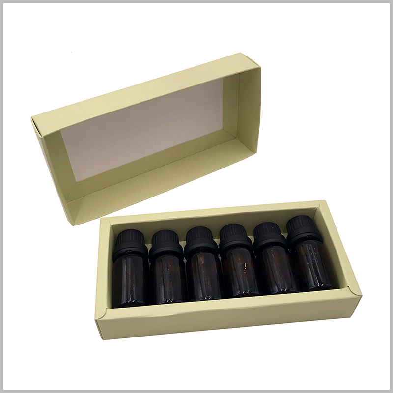 6 bottles of small essential oil bottle packaging. Kraft paper is printed to form an essential oil package, and the boxes can hold 6 bottles of essential oil at a time.