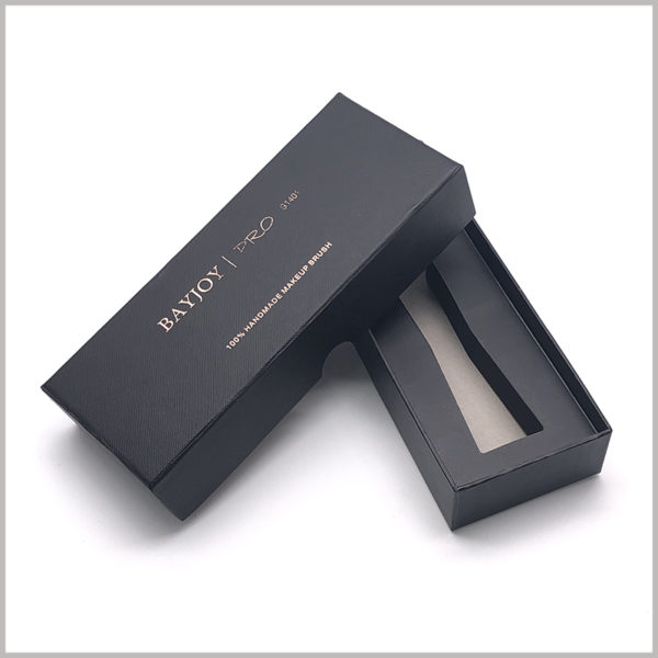Black small cardboard boxes for single makeup brush packaging. The front panel of the customized cosmetic brush box is bronzing printed with brand information and product models.