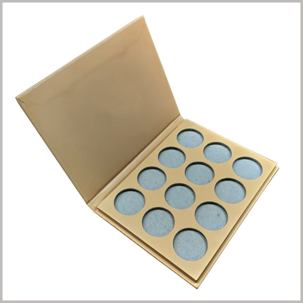 "Brown Kraft paper packaging for 12-color eye shadow box. The size of the eyeshadow palette is customized. Inside the box, 12 different colors of eyeshadow can be placed in ""three rows and four columns"""
