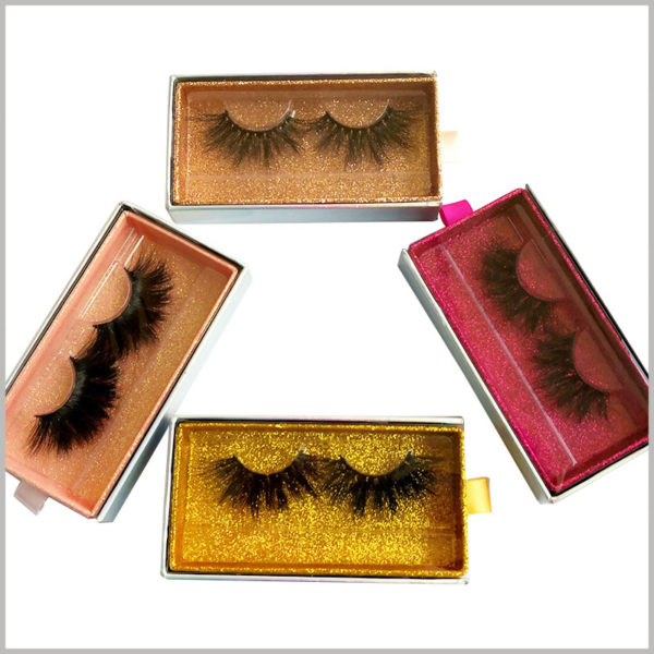 Custom Cardboard drawer eyelash packaging box with window and ribbon. There are many types of luxury eyelash packaging, from which you can choose the most suitable eyelash packaging and wholesale.