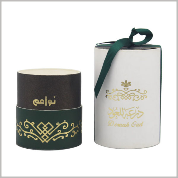 Custom cardboard tube gift boxes for perfume packaging.Use gift bows as decoration on top of printed round cardboard boxes.