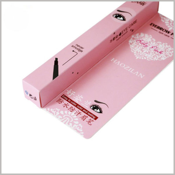 Custom pink small product boxes for eyeliner pencil packaging. The style of the eyeliner and the picture of the scene after use are printed on the small box.