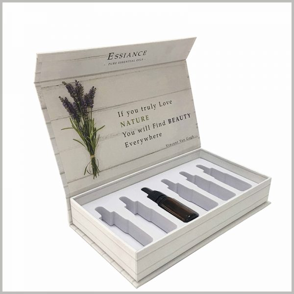 Custom white cardboard boxes for essential oil packaging of 6 bottle.The inside of the packaging cover can be printed with seditious promotional slogans, which will play a positive role in the use of the product.