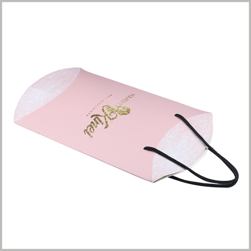 Foldable Pink pillow boxes for hair bundles packaging. Pillow boxes packaging is an easy-to-fold product packaging with low manufacturing cost and low transportation cost.