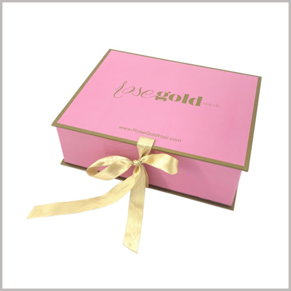 Foldable hard cardboard gift boxes for wig packaging,Pink outer packaging background, yellow narrow silk cloth as a gift knot, has been chased by female consumers.