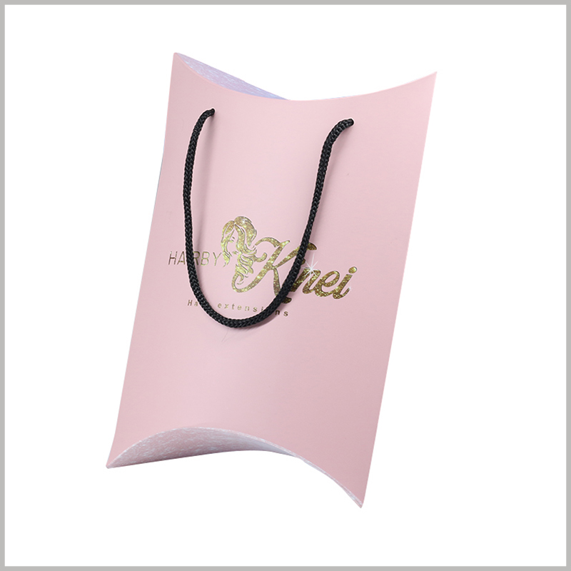 Pink pillow boxes for hair bundles packaging. The pattern and brand name of the wig can be printed by bronzing, which is reflected on the surface of the customized packaging to strengthen the promotion of the product.