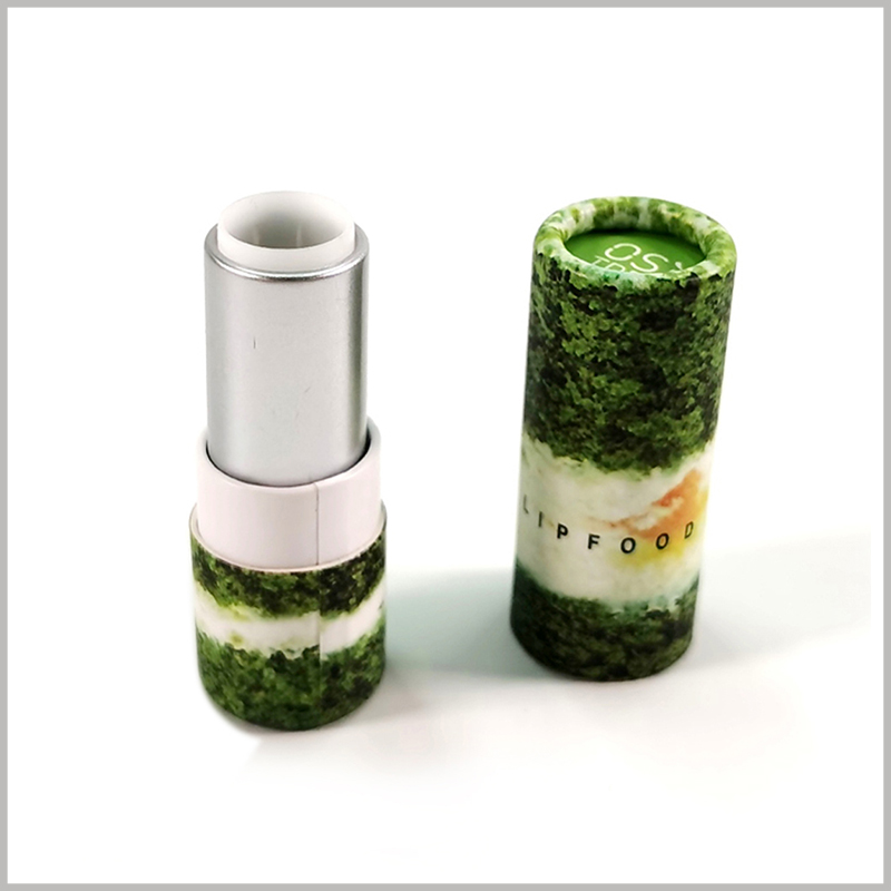 Printed paper lipstick tube packaging boxes wholesale. The plastic cover of the lipstick is silver, and the bottom of the paper tube can be rotated to push the lipstick up, and the product can be used.