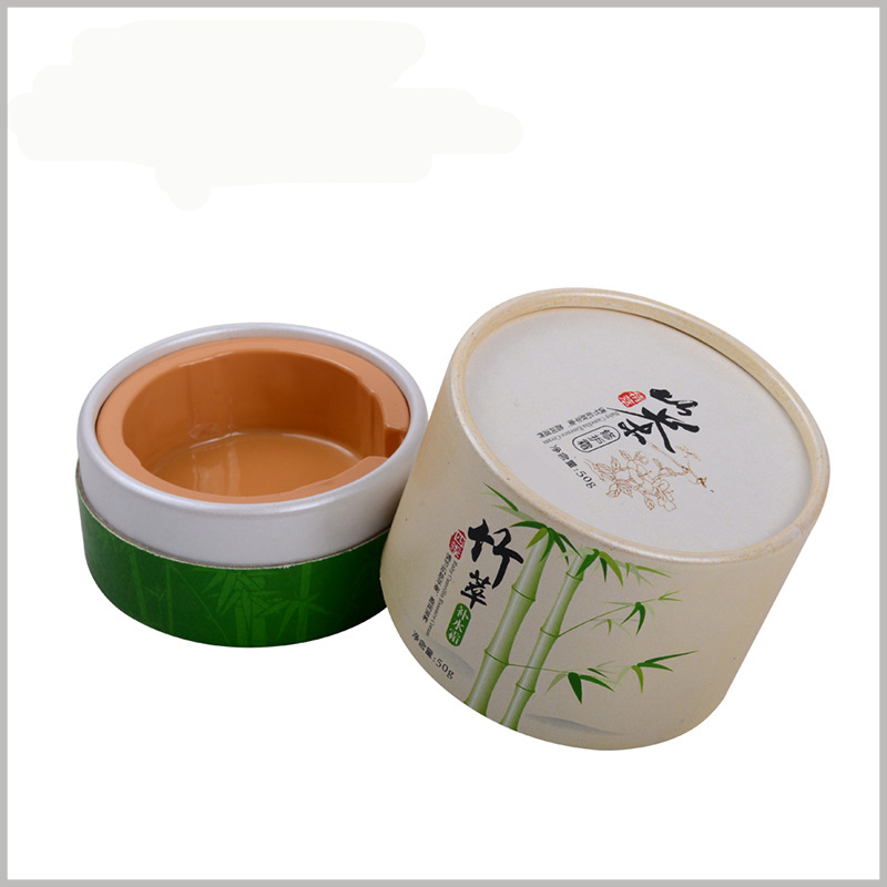 Small round boxes for 50g baby skin care products packaging. The brand LOGO is printed with spot colors and printed with bamboo leaves and other elements on the top and around. No added ideas.