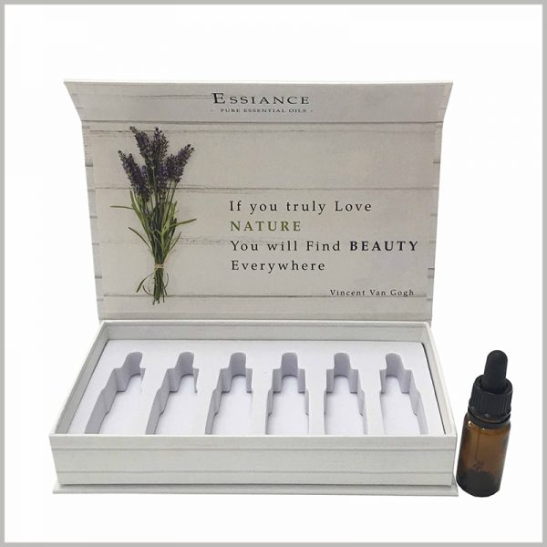 White cardboard boxes for essential oil packaging of 6 bottle,There are EVA gaskets on the bottom of the box, and part of the hollow EVA can fix the essential oil glass bottle to protect the stability of the product.