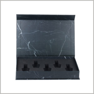 black cardboard boxes for 5 bottles nail polish packaging. The interior of the cosmetic packaging is a specially designed EVA so that the nail polish is arranged inside the box in a specific form.