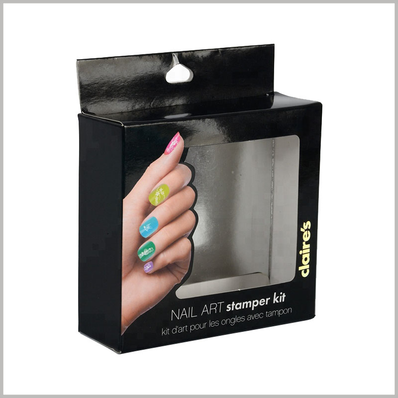 black packaging box for nail art stamper kit. The hands behind the nails are artistic and use them as the main promotional image for custom packaging.