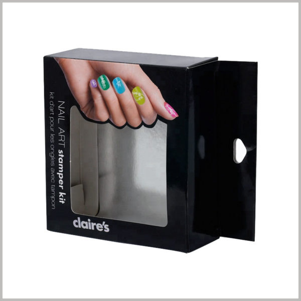 custom black packaging with windows for nail art stamper kit. The protruding paper part on the top of the cosmetic packaging box can become a hook, which is conducive to the display of products on the shelf.