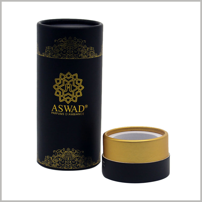 black round gift boxes for perfume bottles packaging. The logo and pattern on the paper tube are printed with bronzing, which has a good visual experience.