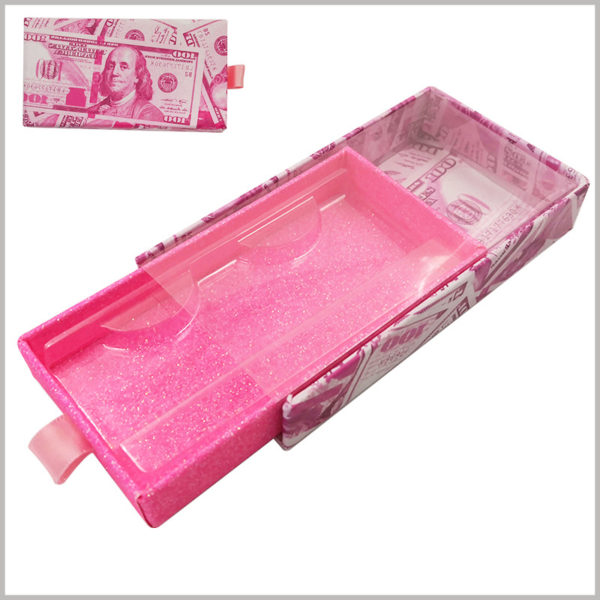cardboard lash boxes with US dollar pattern designing. The bottom of the inner box of the drawer is decorated with glittering red paper to improve the visual experience inside the packaging and increase the value of the eyelash products.