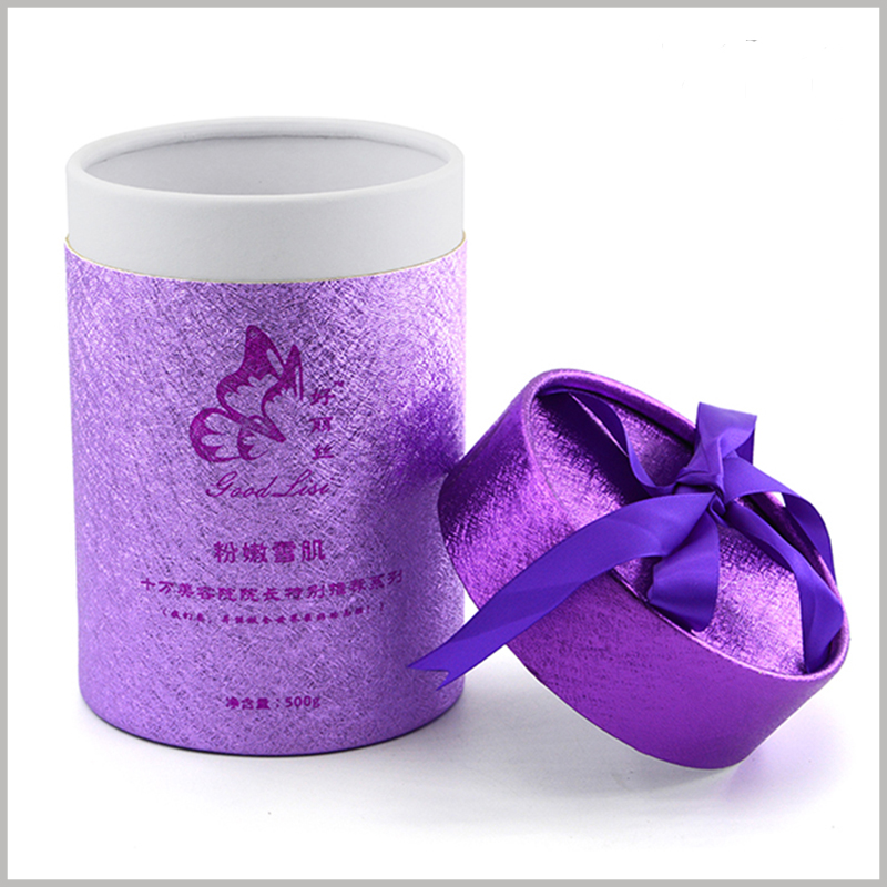 cardboard tube gift boxes packaging for skin care products.The purple silk ribbon as a gift knot is located on the top of the paper tube, which increases the value and value of the product.