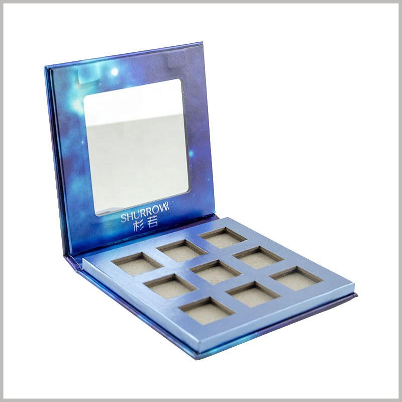 custom 9 colors eyeshadow palette box packaging with mirror. Nine eye shadow trays with different colors are embedded inside the eye shadow packaging.