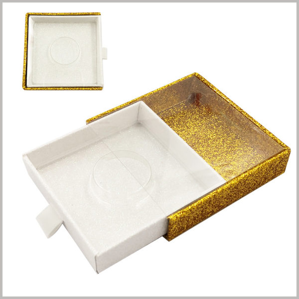 custom Glittering square cardboard drawer eyelash boxes with windows. The shiny gold cardboard is used as the outer box of drawer packaging, which improves the luxury of false eyelash products.