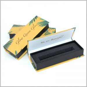 custom small cardboard packaging for lip gloss boxes. The lip gloss packaging box uses 1000gsm gray cardboard as one of the raw materials, which improves the firmness of the packaging.