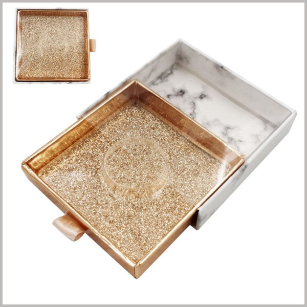 custom small square cardboard drawer eyelash boxes with windows. The drawer inner box uses shiny gold cardboard as the laminated paper to make the packaging more luxurious.
