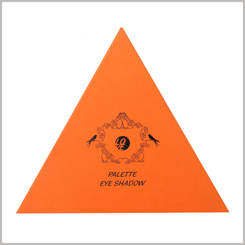 custom triangle boxes for eyeshadow palette packaging. Orange is a warm color and is more easily accepted by customers, so it is used as a background color for cosmetic boxes.