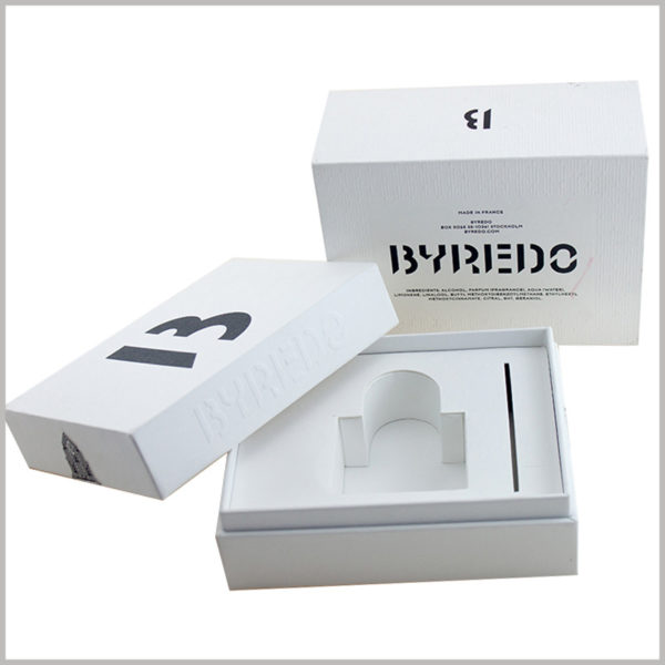 custom white cardboard gift boxes for perfume packaging.The white EVA inside the white boxes can not only fix perfume bottles, but also insert cards, which will bring surprises when consumers open the packaging.