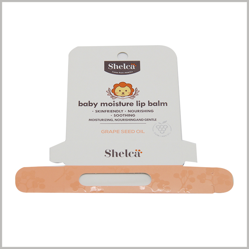 foldable baby moisture lip balm packaging with hang tags. This packaging box uses a folding carton structure, the entire packaging box can be unpacked and tiled into one layer, saving space and convenient transportation.