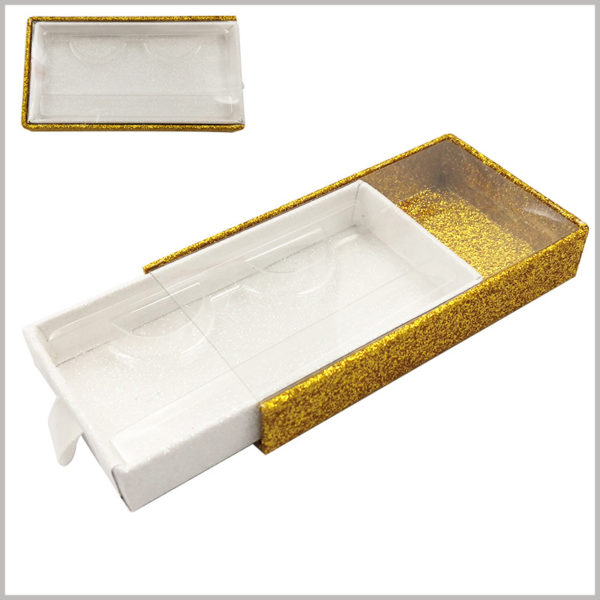 gold Cardboard drawer eyelash packaging box with window and ribbon. The golden cardboard outer drawer box has transparent windows, while the inner drawer box is shiny white.
