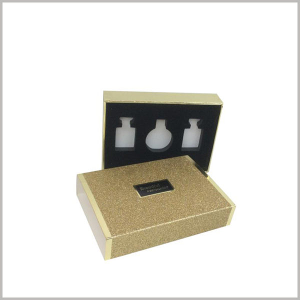 gold cardboard boxes for 3 bottles of perfume packaging.The black flocked EVA has three different hollow shapes for three different types of perfume.