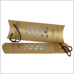 gold pillow boxes for hair extension packaging. The packaging design has many diamond-shaped small windows, through which you can see the wig style inside.
