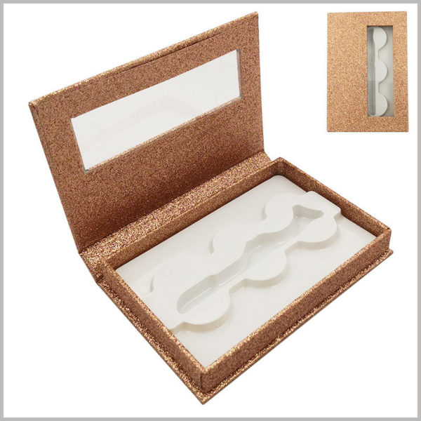 gold shiny eyelash packaing box with window for lot of 3 pairs. The inside of the gold card carton package has white plastic fixed eyelashes, and the top cover has a transparent window to see part of the product style.