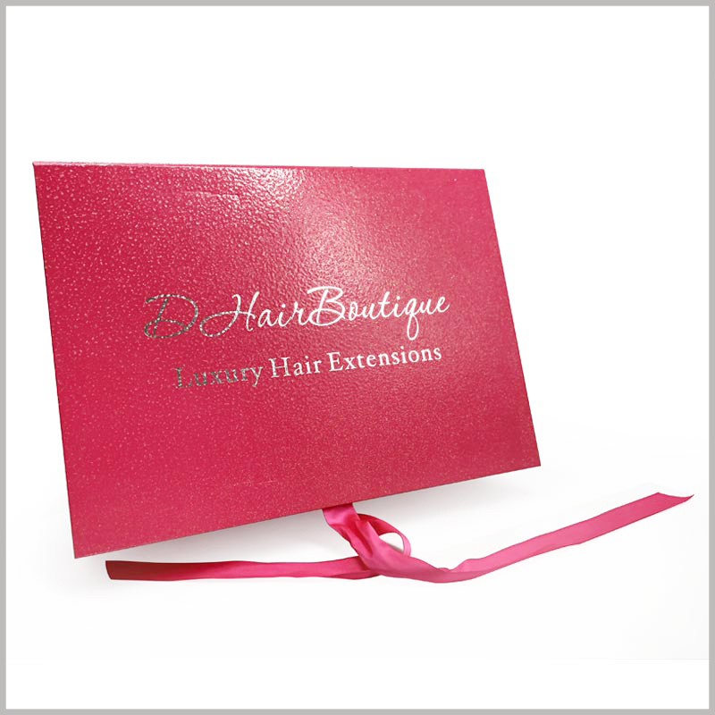 large red gift boxes for hair extensions packaging. The surface of the hair extension packaging adopts light glue technology, the packaging looks more shiny and has a slight reflection.