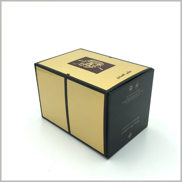 luxury large gold cardboard boxes for perfumes packaging.Detailed product information is printed in white font on the black bottom of the cardboard boxes.