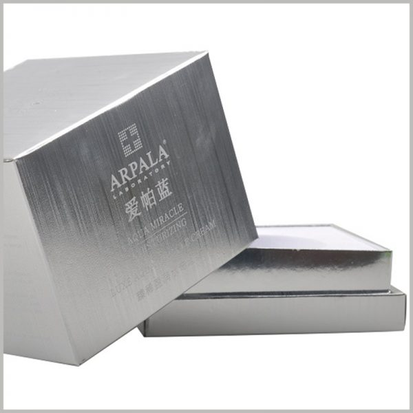 luxury silver packaging for skincare light cream. Silver cardboard covers the entire packaging surface, giving skin care products a luxurious visual experience.