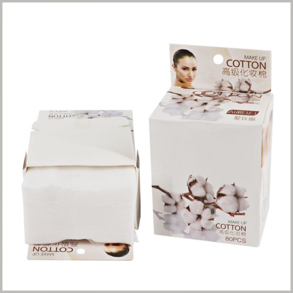 Custom makeup cotton pads packaging boxes. The label surface of the cosmetic packaging has circular holes, allowing the product to be hung on the shelf for display.
