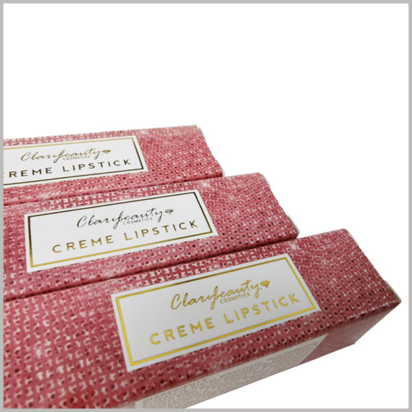 pink cosmetic boxes for creme lipstick packaging. In order to promote the product and brand, bronzing printed the relevant information of the brand and product on the front of the box.