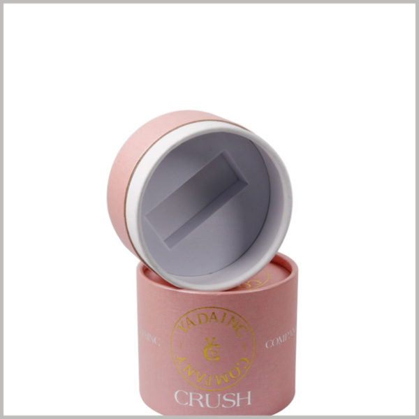 pink small cardoard tube packaging with eva insert, The inside of the cylindrical box lid has a white EVA groove designed according to the shape of the perfume bottle cap.