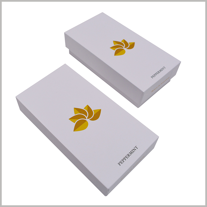 small white cardboard boxes with lids wholesale.The white hard cardboard boxes have a concise packaging design, but they can reflect the brand information and are conducive to product promotion.