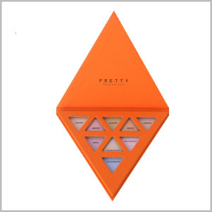 "triangle boxes for eyeshadow palette packaging. The 9-color eye shadows are arranged in the form of ""5-3-1"" inside the box, and the eye shadow tray is also triangular."