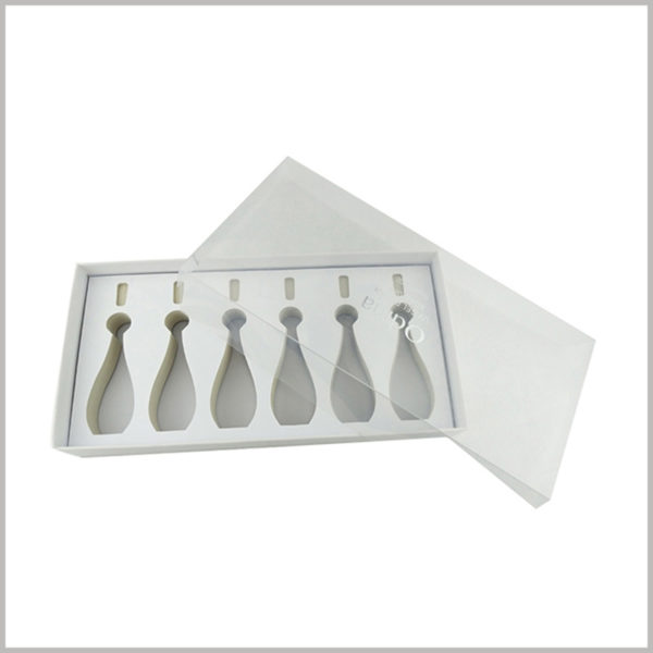 white cardboard packaging for 6 bottles nail polish. The top cover of makeup boxes is completely composed of clear pvc, forming a transparent window to satisfy customers' desire to peek at products.