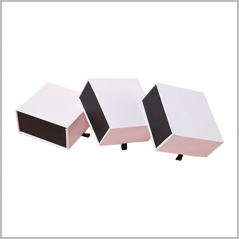 white cardboard perfume boxes packaging wholesale. The white square cardboard boxes are fully customizable and can meet the needs of any product specification.